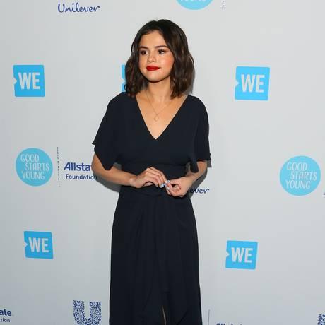 Quem também esteve por lá foi Selena Gomez Foto: JEAN-BAPTISTE LACROIX / AFP