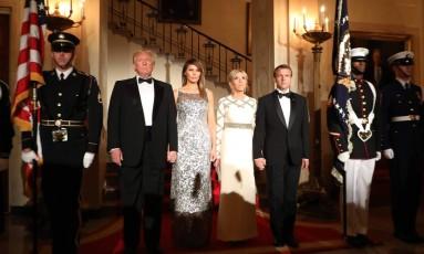 Os casais Trump e Macron no jantar de Estado oferecido ao francês pelo americano, na noite de terça-feira Foto: LUDOVIC MARIN / AFP