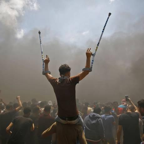 Palestinos protestam na Faixa de Gaza contra transferência da embaixada dos EUA de Tel Aviv para Jerusalém Foto: MOHAMMED ABED / AFP