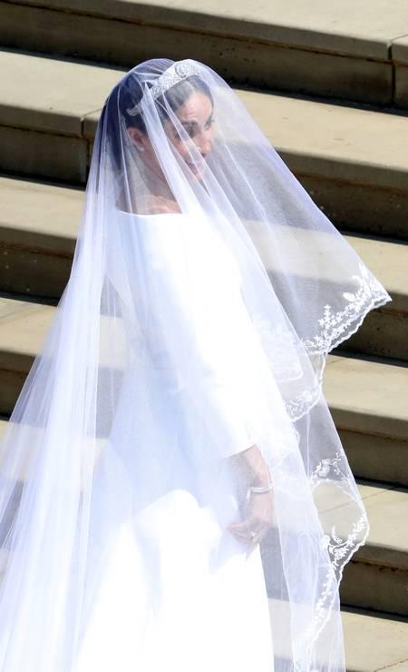 Meghan Markle escolheu um vestido da Givenchy para se casar com o príncipe Harry. Apesar de francesa, a grife é pilotada pela estilista britânica Clare Waight Keller Foto: POOL / REUTERS