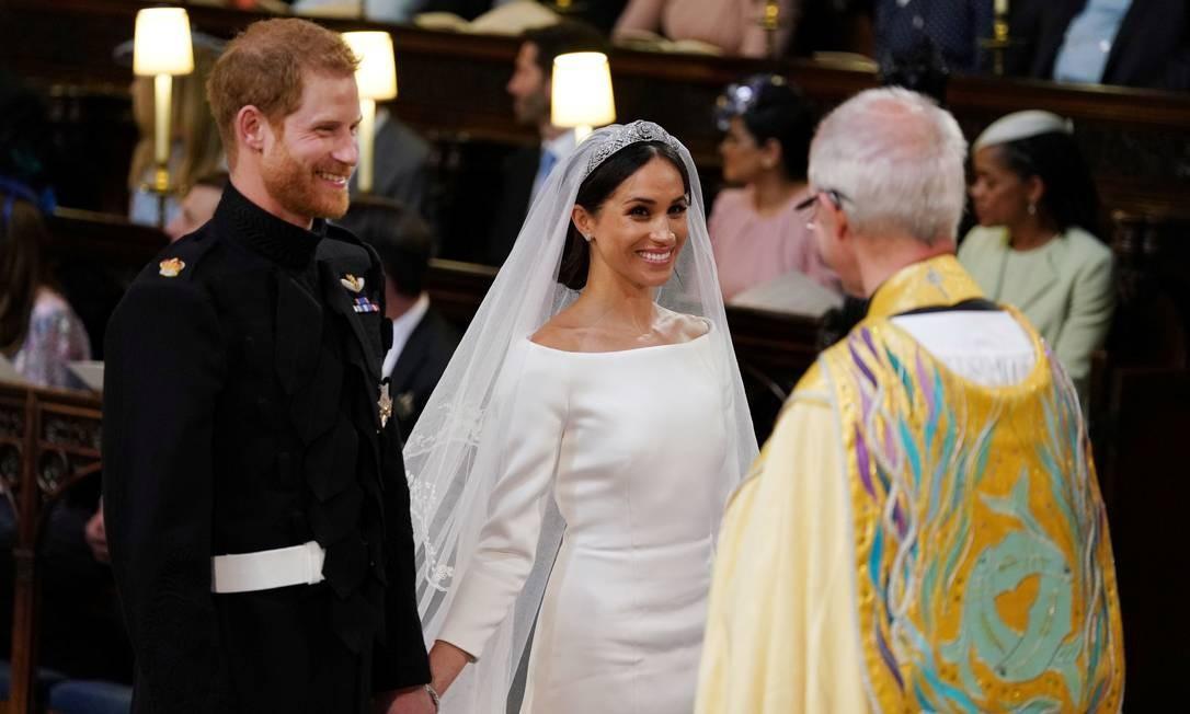 Príncipe Harry e Meghan Markle trocam votos na Capela de São Jorge no Castelo de Windsor durante o seu casamento, conduzido pelo Arcebispo de Canterbury Justin Welby Foto: POOL / REUTERS