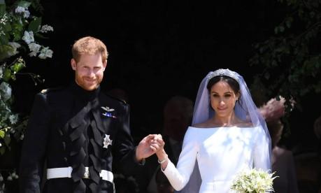 Príncipe Harry e Meghan, na saída da Capela de São Jorge, em Windsor Foto: POOL / REUTERS