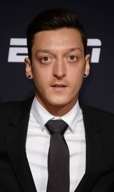 """O alemão Mesut Özil tem até uma marca de roupa: """"Moda é minha paixão"""", escreveu ele no site de sua grife Anthony Harvey / Getty Images for BT Sport Industry Awards"""
