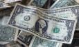 Dólar, a moeda oficial dos Estados Unidos Foto: Mark Lennihan / AP