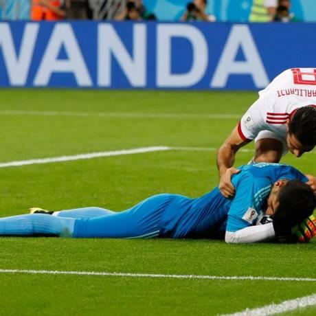 Publicidade da Wanda no fundo do jogo entre Irã e Portugal Foto: JACK GUEZ / AFP