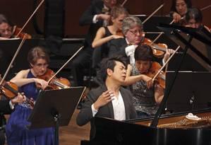 Lang Lang se apresentando com a Filarmônica de Nova York, em 2015 Foto: HIROYUKI ITO / NYT
