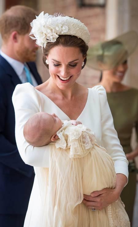O bebê chegou dormindo ao evento, no colo ca mãe POOL / REUTERS