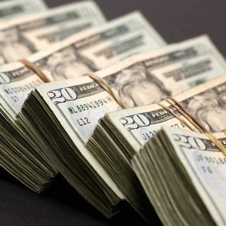 Cédulas de dólar, a moeda oficial dos Estados Unidos Foto: Jose Luis Gonzalez/Reuters