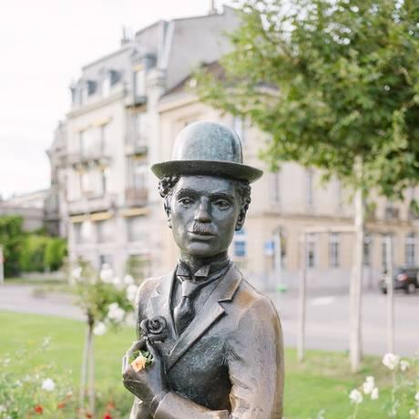 Uma estátua de Charlie Chaplin perto da orla do lago em Vevey, na Suíça Foto: Clara Tuma / The New York Time