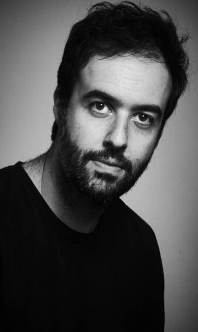 """Emilio Fraia, editor da Companhia das Letras, na mesa """"A não ficção em quadrinhos"""" Marcelo Saraiva"""