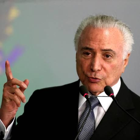 O presidente Michel Temer, durante cerimônia no Palácio do Planalto Foto: Ailton de Freitas / Agência O Globo