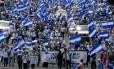 Protesto contra o presidente nicaraguense, Daniel Ortega, nas ruas de Manágua Foto: MARVIN RECINOS / AFP