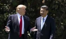 O presidente americano Donald Trump e o líder chinês Xi Jinping em encontro na Flórida, em abril de 2017. , Florida, April 7, 2017. Foto: AFP PHOTO / JIM WATSON