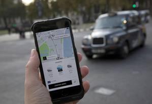 Aplicativo da Uber Foto: Simon Dawson/Reuters