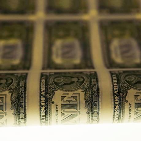 Notas de um dólar são impressas em Washington Foto: Gary Cameron/Reuters/14-11-2014