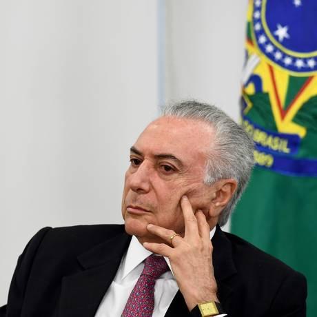 O presidente Michel Temer, durante cerimônia no Palácio do Planalto Foto: Evaristo Sá / AFP