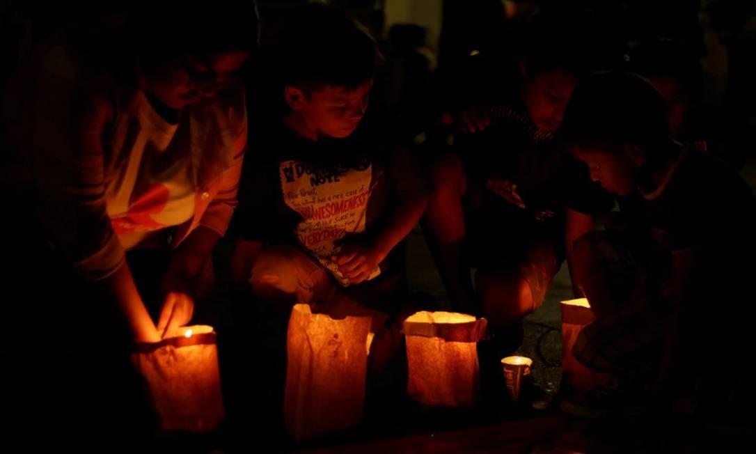 Crianças durante vigília para marcar o Dia Internacional das Vítimas de Desaparecimentos Forçados, em Ciudad Juárez, México Foto: JOSE LUIS GONZALEZ / REUTERS/30-8-2018