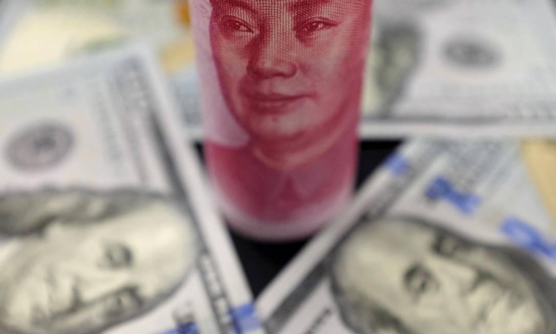 Yuan X Dólar: mecanismo adotado pelo BC chinês tenta reduzir tensões com os EUA Foto: Jason Lee / REUTERS