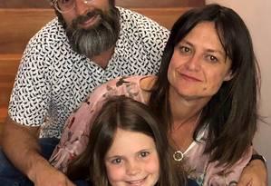 Harper e os pais, Mark e Yvette Miller Foto: Davey Miller/The New York Times