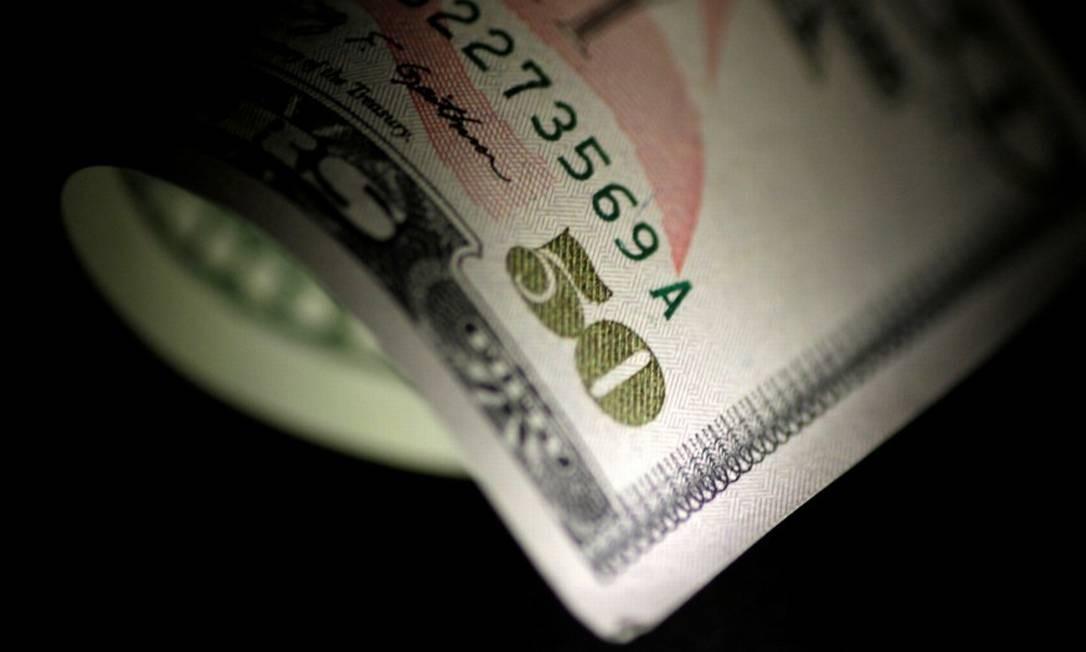 Cédula de dólar, a moeda oficial dos Estados Unidos Foto: Thomas White / Reuters