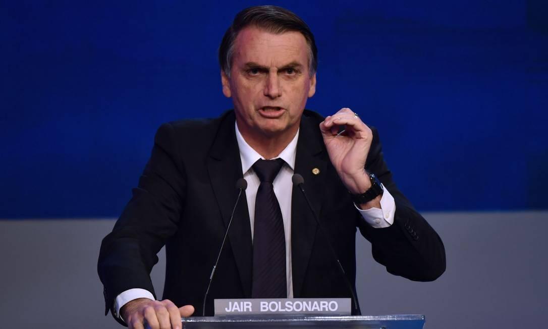 O candidato Jair Bolsonaro no debate promovido pela Band, no dia 9 de agosto Foto: Nelson Almeida / AFP