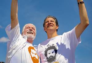 O candidato do PT ao Senado pela Bahia, Jaques Wagner, e o presidenciável Fernando Haddad Foto: Reprodução/Facebook