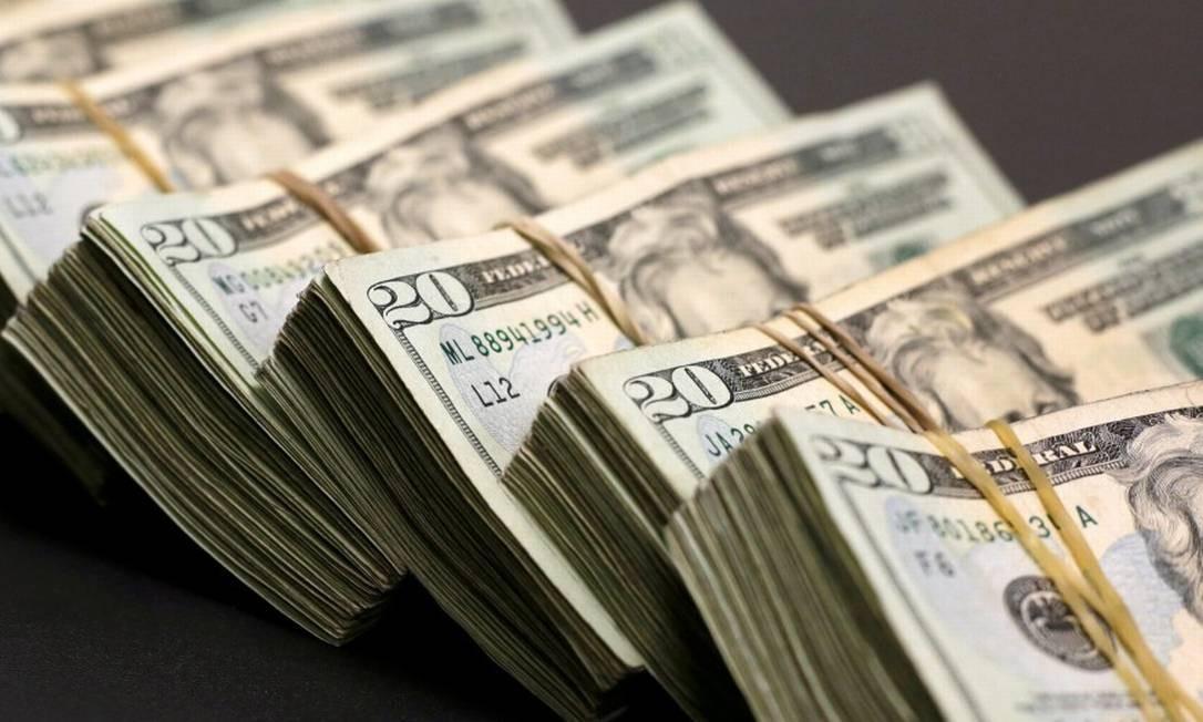 Cédulas de dólar, a moeda oficial dos Estados Unidos Foto: Jose Luis Gonzalez / Reuters