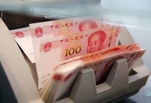 Yuan caiu mais de 8% em relação ao dólar desde o final de abril Foto: Reuters Photographer / REUTERS