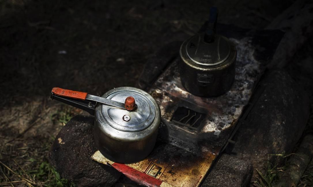 Situação análoga à escravidão em área rural Foto: Guito Moreto / Agência O Globo