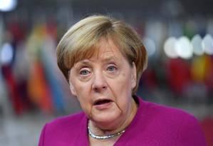 Merkel cobrou respostas sobre o crime Foto: EMMANUEL DUNAND / AFP
