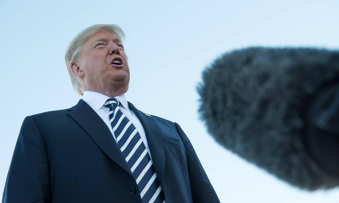 O presidente dos EUA, Donald Trump, citou a falta de restrições ao desenvolvimento de mísseis pela China como uma das razões para deixar o tratado Foto: NICHOLAS KAMM / AFP
