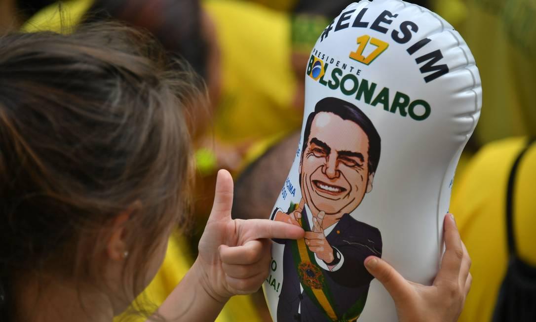 Apoiadores de Bolsonaro em manifestação a favor do candidato, em São Paulo Foto: Nelson Almeida / AFP