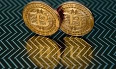 Esta foto de 17 de junho de 2014 tirada em Washington, EUA, mostra medalhas de bitcoin Foto: AFP