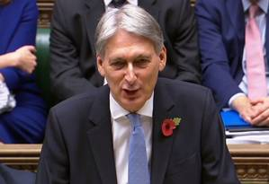 Philip Hammond, em sua fala ao Parlamento Foto: PRU / AFP