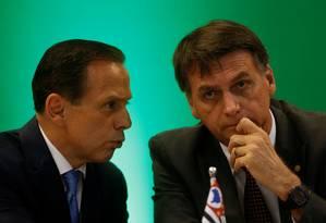 O governador eleito de São Paulo, João Doria, conversa com o presidente eleito, Jair Bolsonaro, durante evento em Brasília Foto: Adriano Machado / Reuters