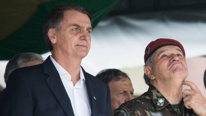 O presidente eleito Jair Bolsonaro durante cerimônia na Vila Militar Foto: FERNANDO SOUZA / AFP