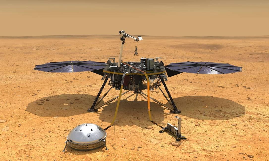 Ilustração da Nasa mostra a sonda InSight em Marte, já com os painéis solares abertos e seus instrumentos instalados na superfície do planeta: missão deverá durar cerca de dois anos terrestres Foto: NASA/JPL-Caltech