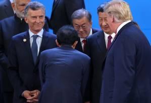 O presidente Donald Trump e o chinês Xi Jinping se encontram durante o G-20 em Buenos Aires Foto: MARCOS BRINDICCI/REUTERS