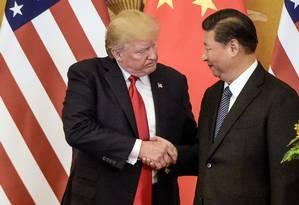 Acordo entre presidente americano Donald Trump e líder chinês Xi Jinping Foto: FRED DUFOUR/AFP/9-11-2017