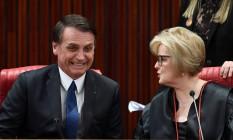 O presidente eleito Jair Bolsonaro e a presidente do TSE, Rosa Weber Foto: Evaristo Sá/AFP