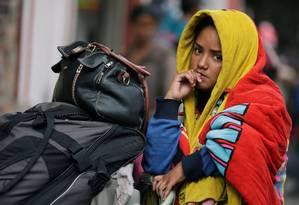 Imigrante venezuelana em acampamento temporário na capital colombiana, Bogotá Foto: Luisa Gonzalez / REUTERS