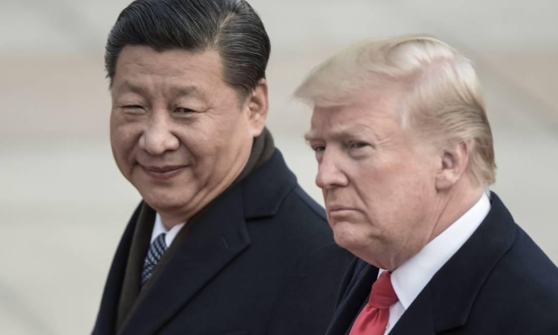 O presidente chinês Xi Jinping (L) e dos EUA Donald Trump Foto: FRED DUFOUR / AFP