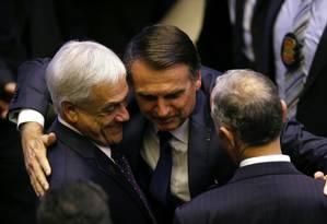O presidente Jair Bolsonaro cumprimenta os presidentes do Chile (Sebastian Piñera) e Portugal (Marcelo Rebelo de Sousa) Foto: Adriano Machado/Reuters