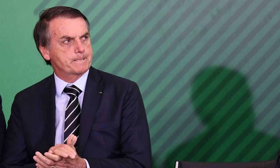 O presidente Jair Bolsonaro durante a transmissão de cargo de ministros no Palácio do Planalto Foto: Evaristo Sá / AFP