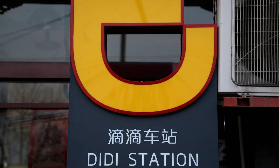 O logotipo da Didi Chuxing é visto em uma estação da empresa em Pequim Foto: JASON LEE / REUTERS