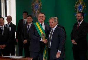 O presidente Jair Bolsonaro e o ministro da Economia, Paulo Guedes Foto: Daniel Marenco / Agência O Globo