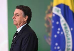 O presidente Jair Bolsonaro durante cerimônia de transmissão de cargo de alguns dos ministros de seu gabinete Foto: EVARISTO SA / AFP