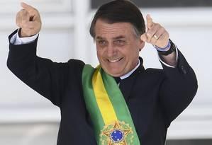 Depois de vestir a faixa, Bolsonaro discursa no parlatório Foto: Evaristo Sá/AFP
