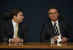 Rodrigo Maia e Jair Bolsonaro participam da posse de novos procuradores federais Foto: Daniel Marenco / Agência O Globo