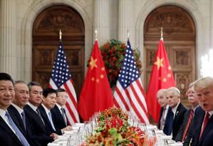 Xi Jinping e Trump no G20, em dezembro, quando foi combinada a trégua de três meses na guerra comercial Foto: Kevin Lamarque / REUTERS